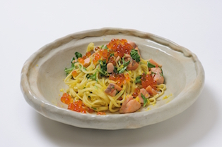Salmon and Mizuna Greens Tagliolini with Notes of Yellow Yuzu Citrus and Generous Serving of Salmon Roe